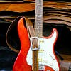 red fender stratocaster with celtic embossed guitar strap in Lee River Leather factory