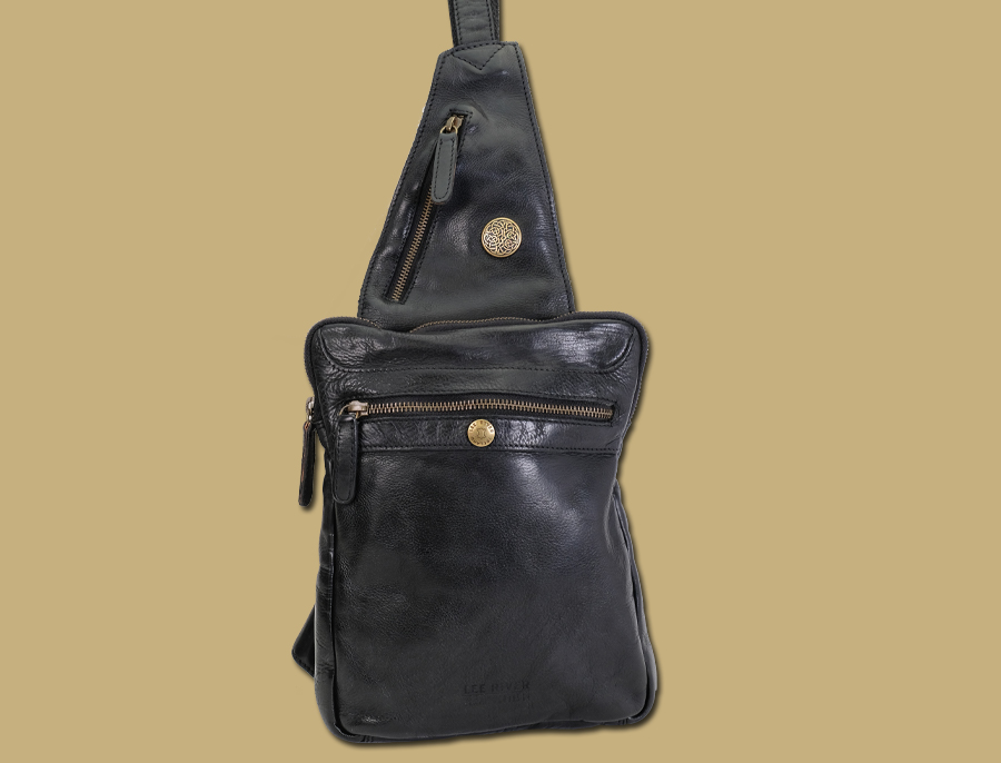 celtic black sling bag with antique brass zip and concho