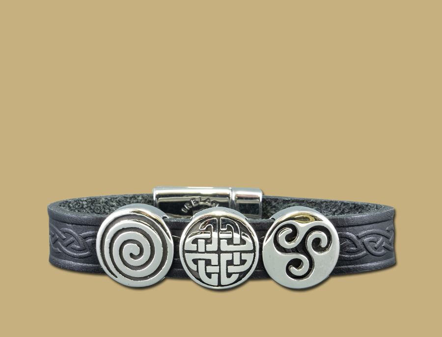 black three charm celtic embossed cuff bracelet with stainless steel clasp