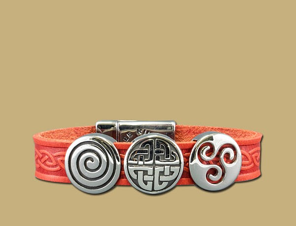 Red three charm celtic embossed cuff bracelet with stainless steel clasp