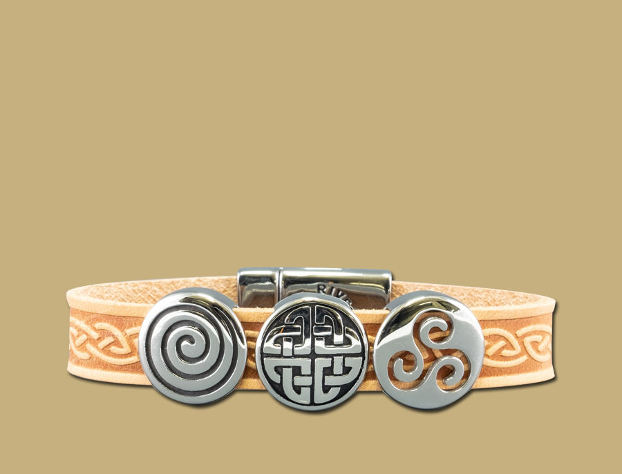 Tan three charm celtic embossed cuff bracelet with stainless steel clasp